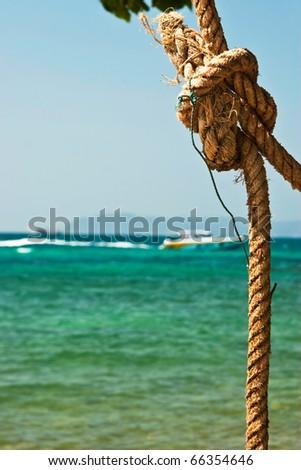 Manila string on the sea beach - stock photo