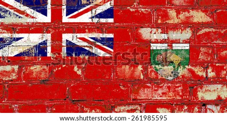 Manitoba flag painted on old brick wall texture background - stock photo