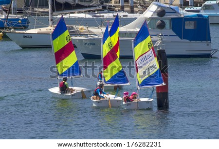 MANLY, AUSTRALIA-DECEMBER 19TH 2013: Children learning the basics of sailing in dinghies in Manly harbour. Sailing is a very popular sport in Australia.