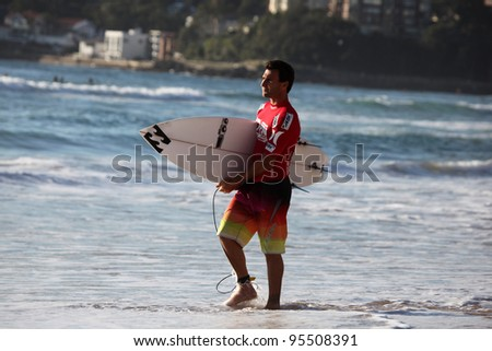 MANLY, AUSTRALIA - FEBRUARY 17: Joel Parkinson, current world number two, readies himself for competition in the Australian Surfing Open at Manly Beach on Feb. 17, 2012 in Manly, Australia. - stock photo