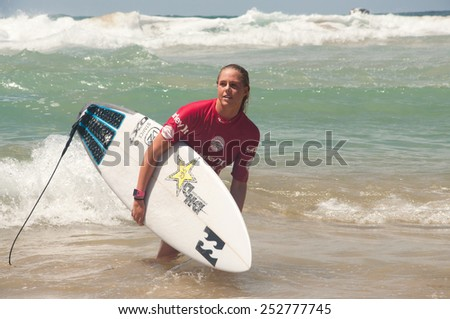MANLY AUSTRALIA - FEBRUARY 15: Laura Enever leaving water after  the competition among women in the Australian Surfing Open at Manly Beach. February 15, 2015 Manly, Australia.  - stock photo