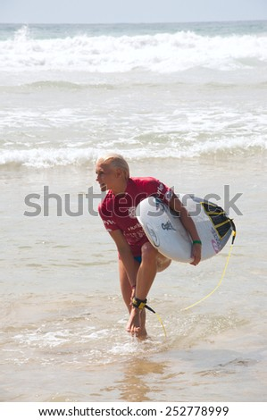 MANLY AUSTRALIA - FEBRUARY 15: Tatiana Weston-Webb leaving water after quarter finals of the competition among women in the Australian Surfing Open at Manly Beach. February 15, 2015 Manly, Australia.  - stock photo