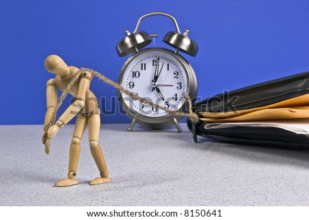 Mannequin dragging his burgeoning dayplanner home from the office.  Dayplanner stuffed with paperwork.  Clock shows quitting time.  Conceptual image for working from home, overworked, etc. - stock photo