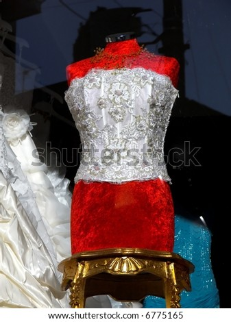 Mannequin dressmaker behind the glass of a showcase of a fashion maison - vintage - stock photo