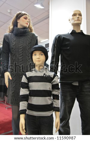 mannequin family in shop - stock photo