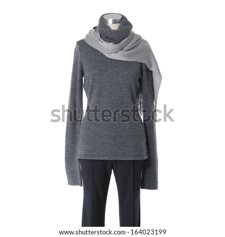 Mannequin female dressed with scarf in trousers �white background