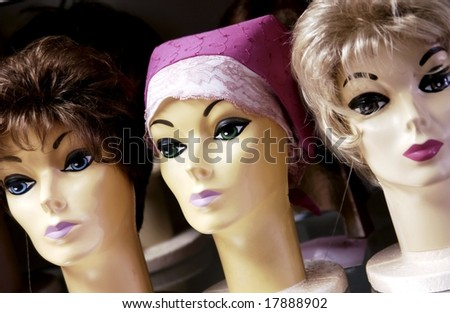 Mannequin heads with wigs - stock photo