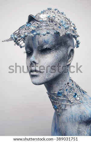 Mannequin in creative silver snow queen crown and collar