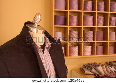 Mannequin in interior of upscale men's clothing shop - stock photo