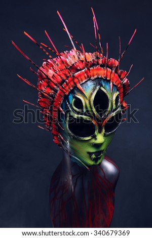 Mannequin in masquerade colorful scary mask
