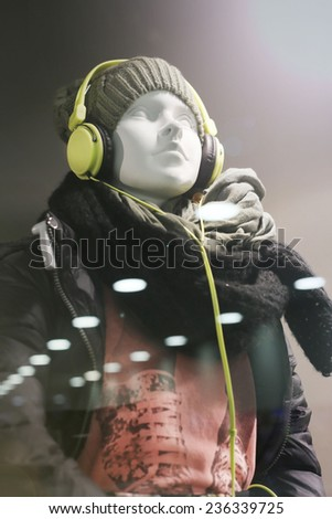 Mannequin in the window of the boutique. No brand names or copyright objects - stock photo