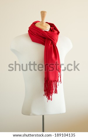 Mannequin Torso displayed with Wrap Scarf Shawl - stock photo