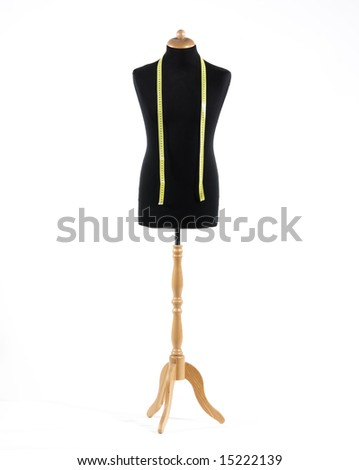 Mannequin with a tape measure a over white background - stock photo