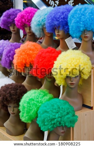 mannequin with colorful wig and facial accessories - stock photo