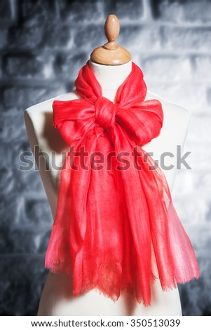 Mannequin with silk cloth. Knitted fashion red organza shawl on tailor bust. Single object with clipping path - stock photo