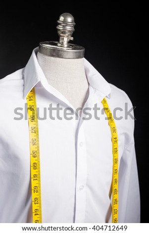 Mannequin with white shirt on it - stock photo