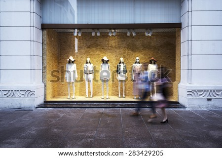mannequins at shopfront - stock photo