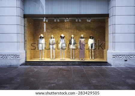 mannequins at shopfront - stock photo