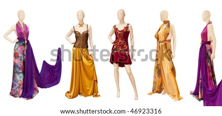 Mannequins dressed in various types of cloth - stock photo
