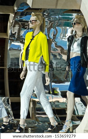 Mannequins in clothes shop - stock photo