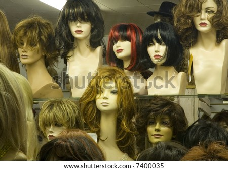 Mannikin heads in a wig store - stock photo