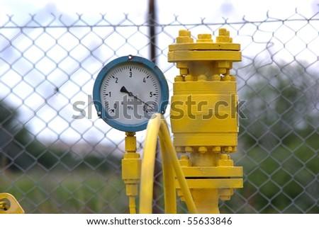 manometer near gas installation on sky background - stock photo