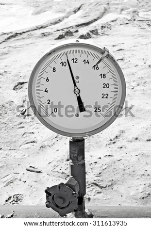 Manometer on a gas pipeline. Controlling gas flow. Gas pumping. Black and white photo - stock photo