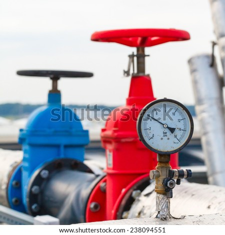manometer, red and blue valve on hot and cold pipe - stock photo