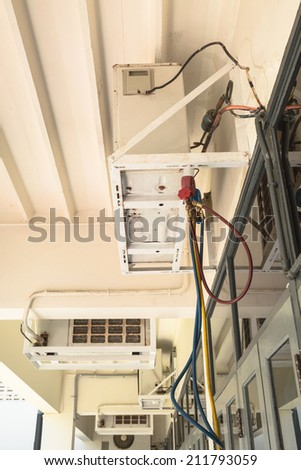 Manometers on equipment for filling air conditioners hanging on ceiling - stock photo