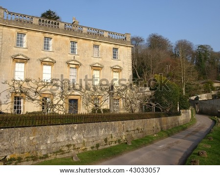 Manor House on a Country Lane - stock photo