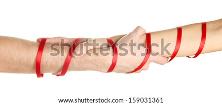 Mans and girls hands tied with ribbon isolated on white - stock photo