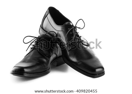 mans black leather shoes on white background - stock photo