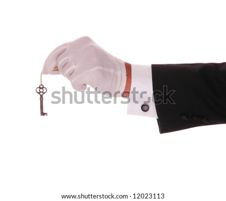 Mans Gloved Hand and Arm With Old Skeleton Key on Gold String - stock photo