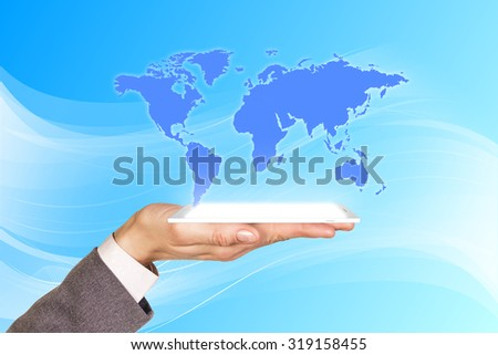 Mans hand holds the phone with projection on the blue background. Elements of this image furnished by NASA