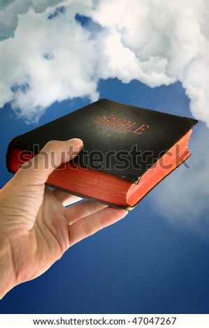 Mans hand is holding a bible - stock photo