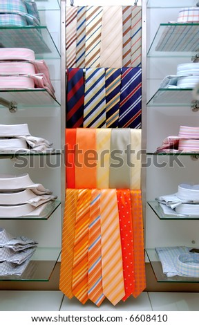 Mans shirts and necktie in store. - stock photo