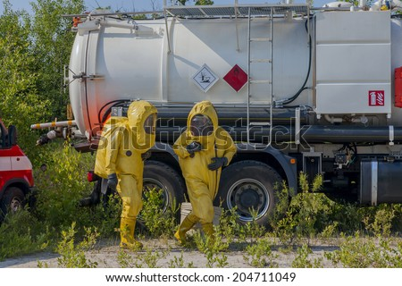 Mans with briefcase in protective hazmat suit. - stock photo