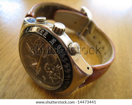 mans wristwatch with leather band - stock photo