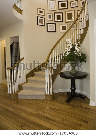 Mansion hallway with modern staircase. - stock photo