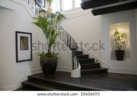 Mansion hallway with staircase and luxurious decor. - stock photo