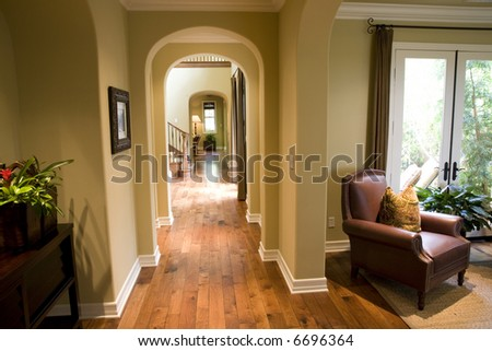Mansion hallway with wood floor. - stock photo
