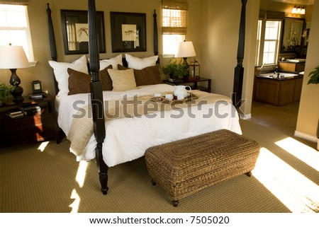 Mansion with comfortable bedroom and luxurious decor. - stock photo