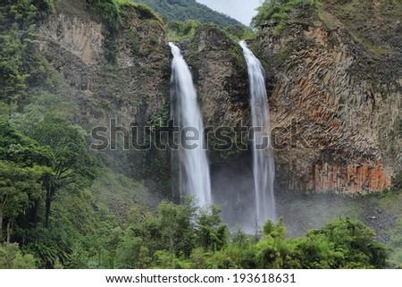 Manto de la novia (bridal veil) waterfall in Cascades route near Banos, Ecuador - stock photo