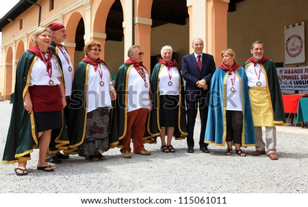 MANTOVA, ITALY - JUNE 13: Local people and authorities after celebrations in Solferino during Golosaria, fair show of food and gastronomy culture June 13, 2010 in Mantova, Italy. - stock photo