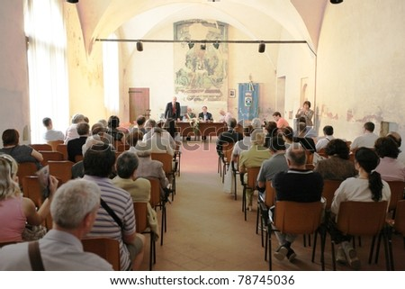 MANTOVA, ITALY - JUNE 14: People assist to conferences during Golosaria, national fair of food and gastronomy culture June 14, 2010 in Mantova, Italy. - stock photo