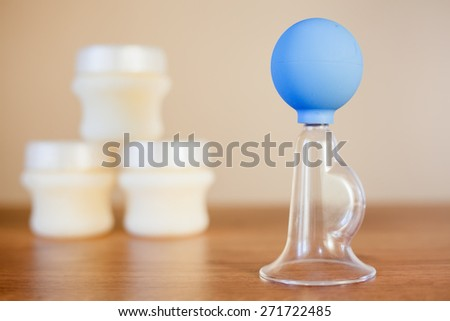 Manual breast pump, mothers breast milk is the most healthy food for newborn baby - stock photo