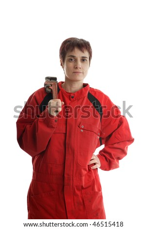 manual female worker with socket wrench in red overall - stock photo