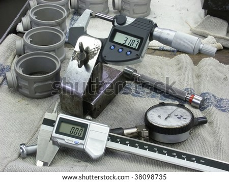 Manual measuring instruments at a workplace - stock photo