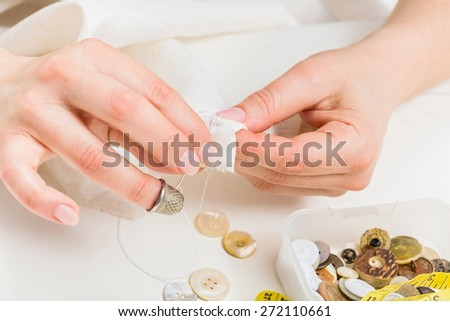 Manual sewing; inserting the needle in fabric for sewing cloth