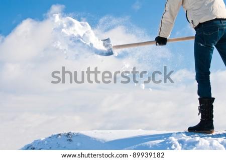 Manual snow removing - stock photo